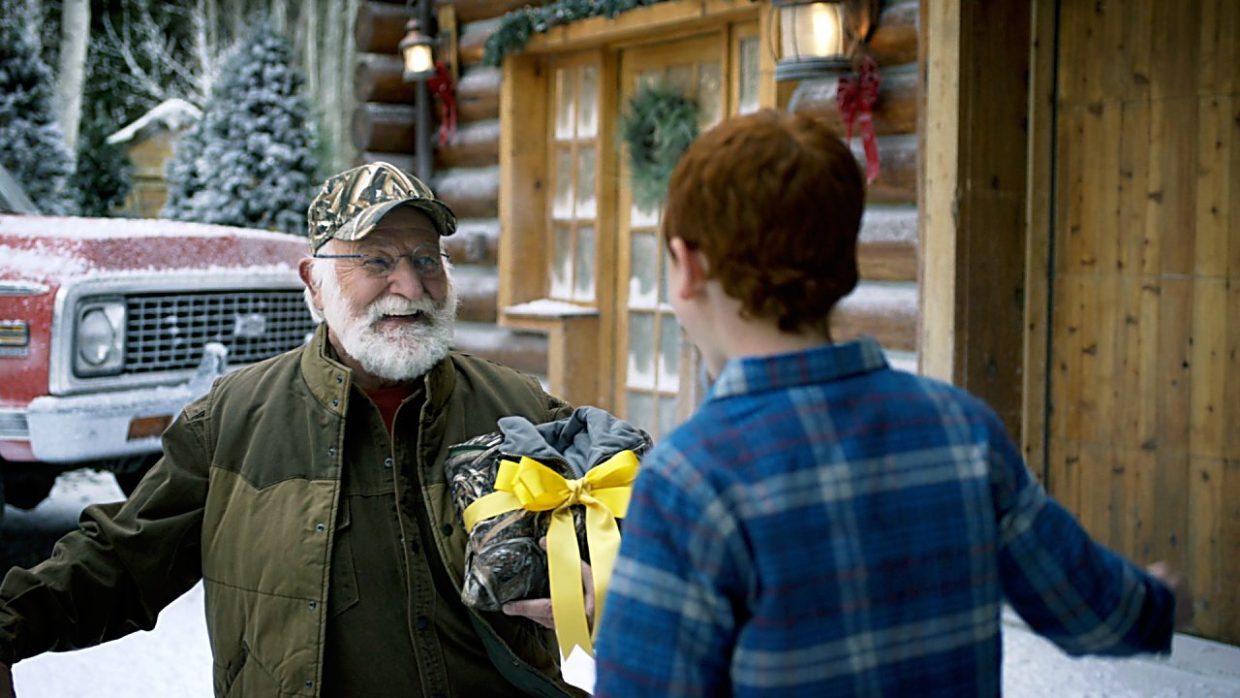 Actor Bob Moore greets the boy playing his grandson in a Cabela's Christmas television advertisement.