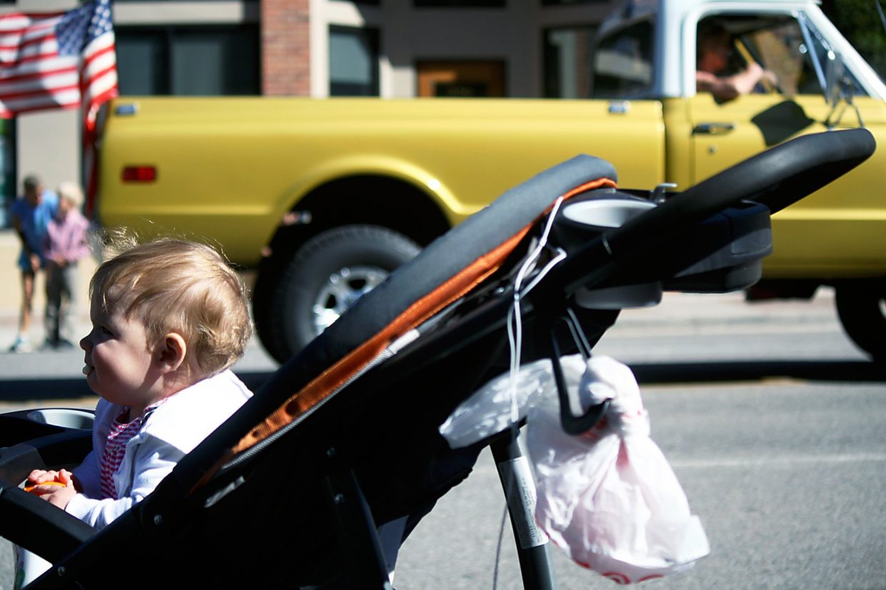 Ten-month-old Lucy Hankins looks on at her first Burning Mountain Festival parade in New Castle Saturday, Sept. 12.