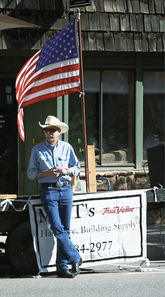New Castle Mayor Pro-Tempore Bruce Leland watches as floats in the Burning Mountain Festival parade travel down Main Street.