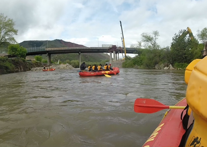 A group of eighth-graders from Glenwood Springs Middle School prepare to go underneath the Grand Avenue bridge during a morning raft trip with Glenwood Canyon Resort.
