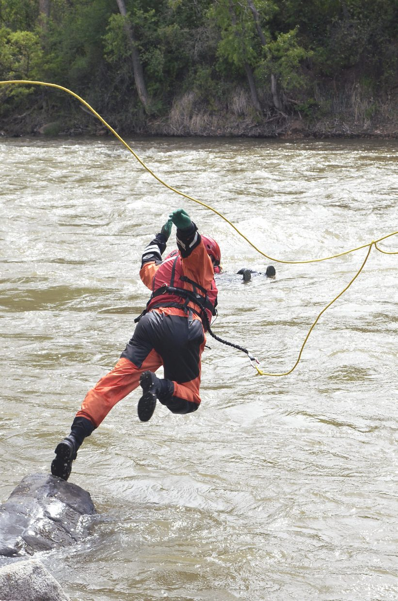 Lt. Eric Daninger of Colorado River Fire Rescue practices a tethered rescue as part of an annual swift water rescue course Wednesday. Glenwood Springs Fire Department teamed up with CRFR and Colorado Division of Fire Prevention and Control for rescue drills on the Roaring Fork River just upstream of its confluence with the Colorado River.