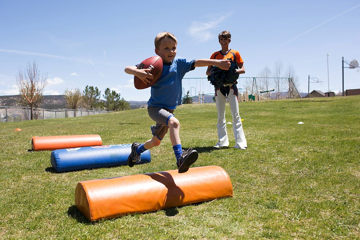 Brush Creek Elementary School student Stella Hawkins leaps for a ball thrown by Denver Broncos wide receiver Bennie Fowler in Eagle on Friday. The Broncos payed a visit to the elementary school as part of a community outreach program.