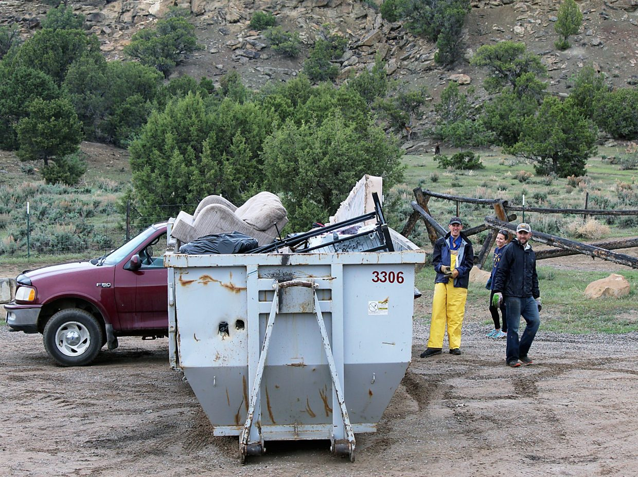 A couch sits on County Road 290 in the Hubbard Mesa open recreation area. Volunteers discovered the couch in a nearby gulch during the annual Hubbard Mesa cleanup Saturday.