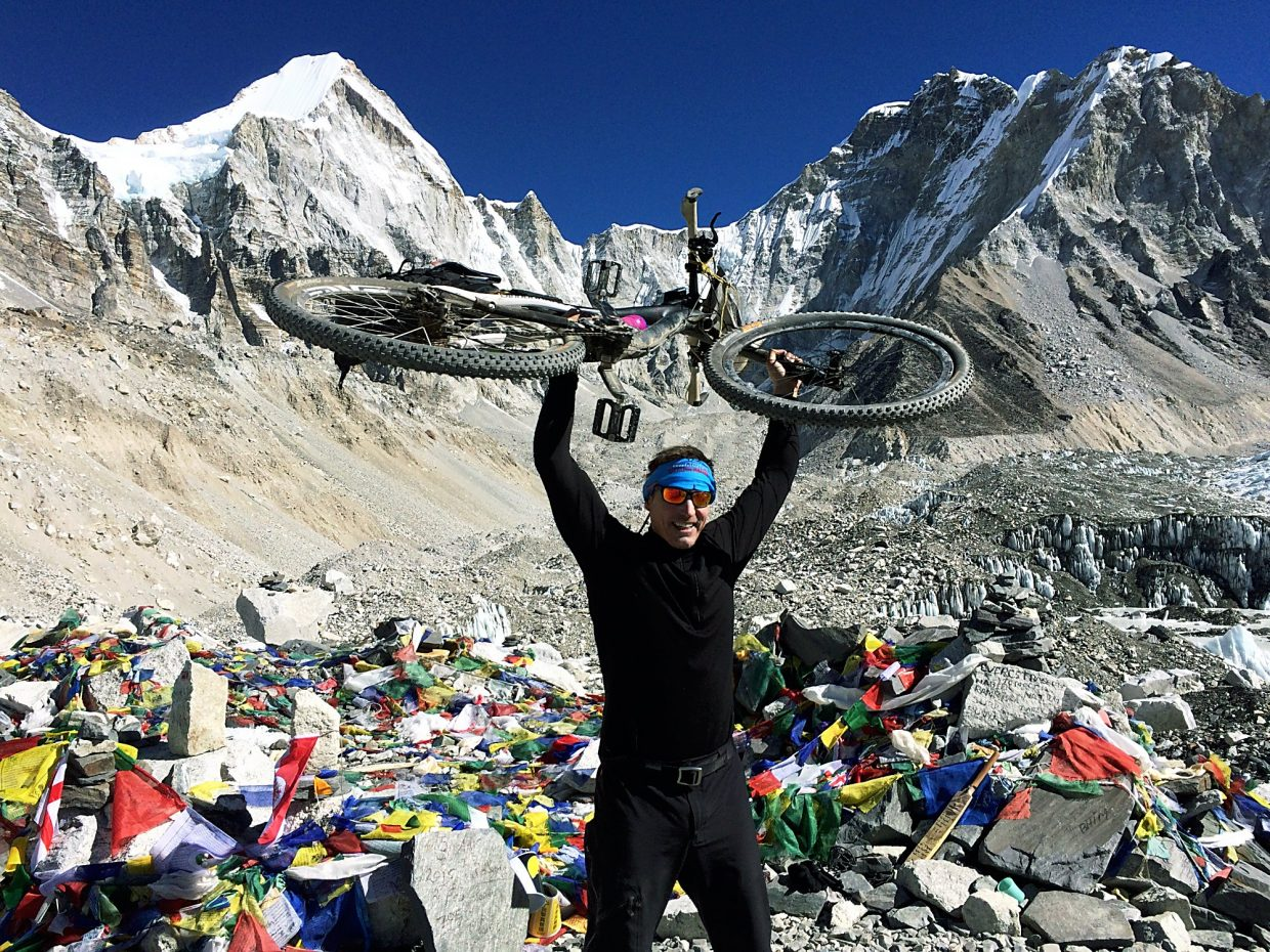 Patrick Sweeney celebrates at Mount Everest base camp on Feb. 24, 2015, nearly 100 miles further and 9,000 feet higher than when he started. Sweeney maintains that he is the first modern rider to bike the Nepali route to base camp, although several others (including Summit locals) have made the ride to the Tibetan base camp over the past few decades.