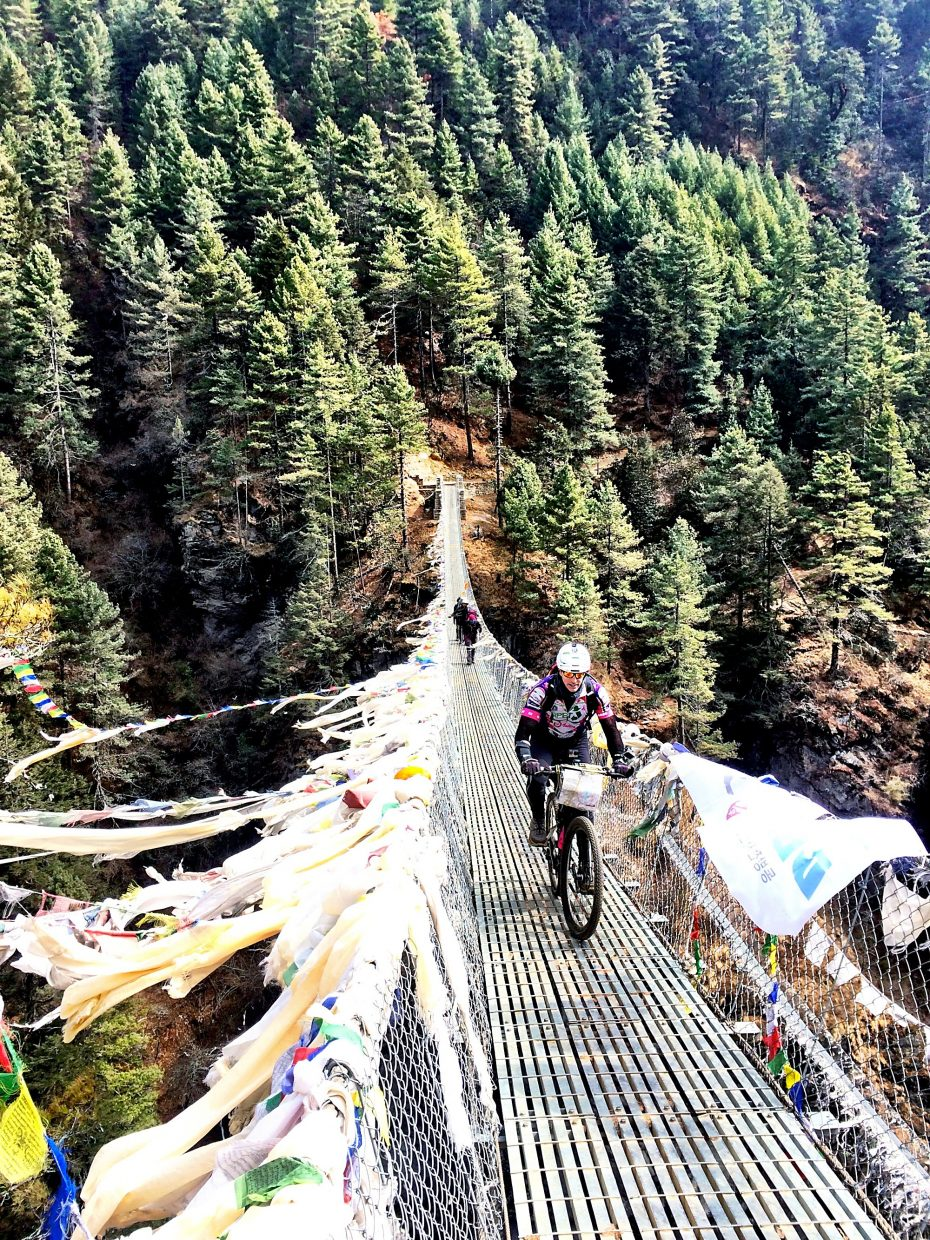 Patrick Sweeney traveled over many bridges covering 1,000-foot drops on his mountain bike voyage to Mount Everest base camp.