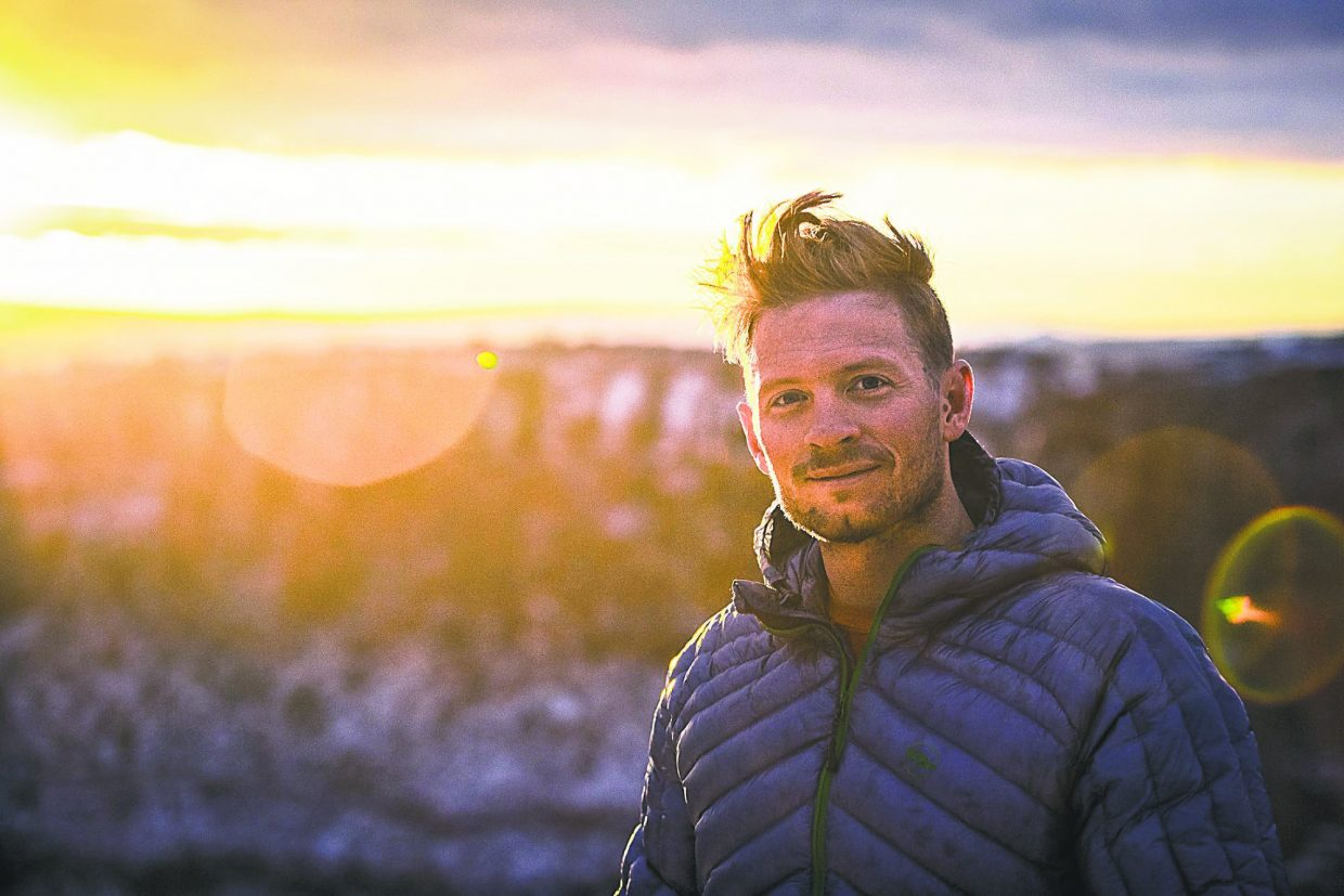 Jim Harris greets the sunrise after fulfilling a post injury goal of camping near Moab on his birthday.