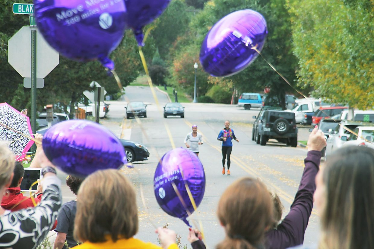 A crowd of supporters greets Jenny LaBaw as she arrives at Valley View Hospital Monday on her cross-state run.