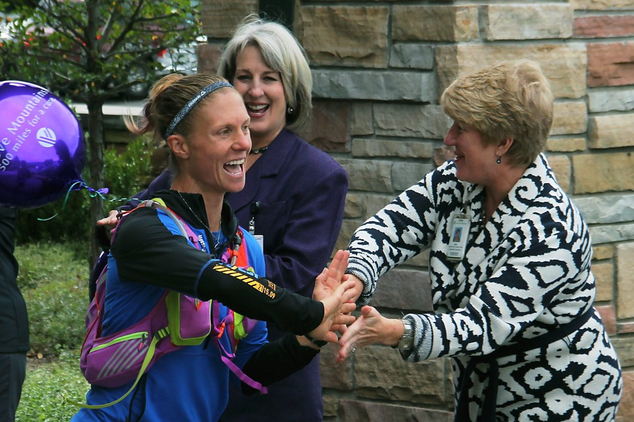 Supporters greet Jenny LaBaw of Rifle on Monday at Valley View Hospital, a stop on her cross-state run to raise money and awareness of epilepsy.
