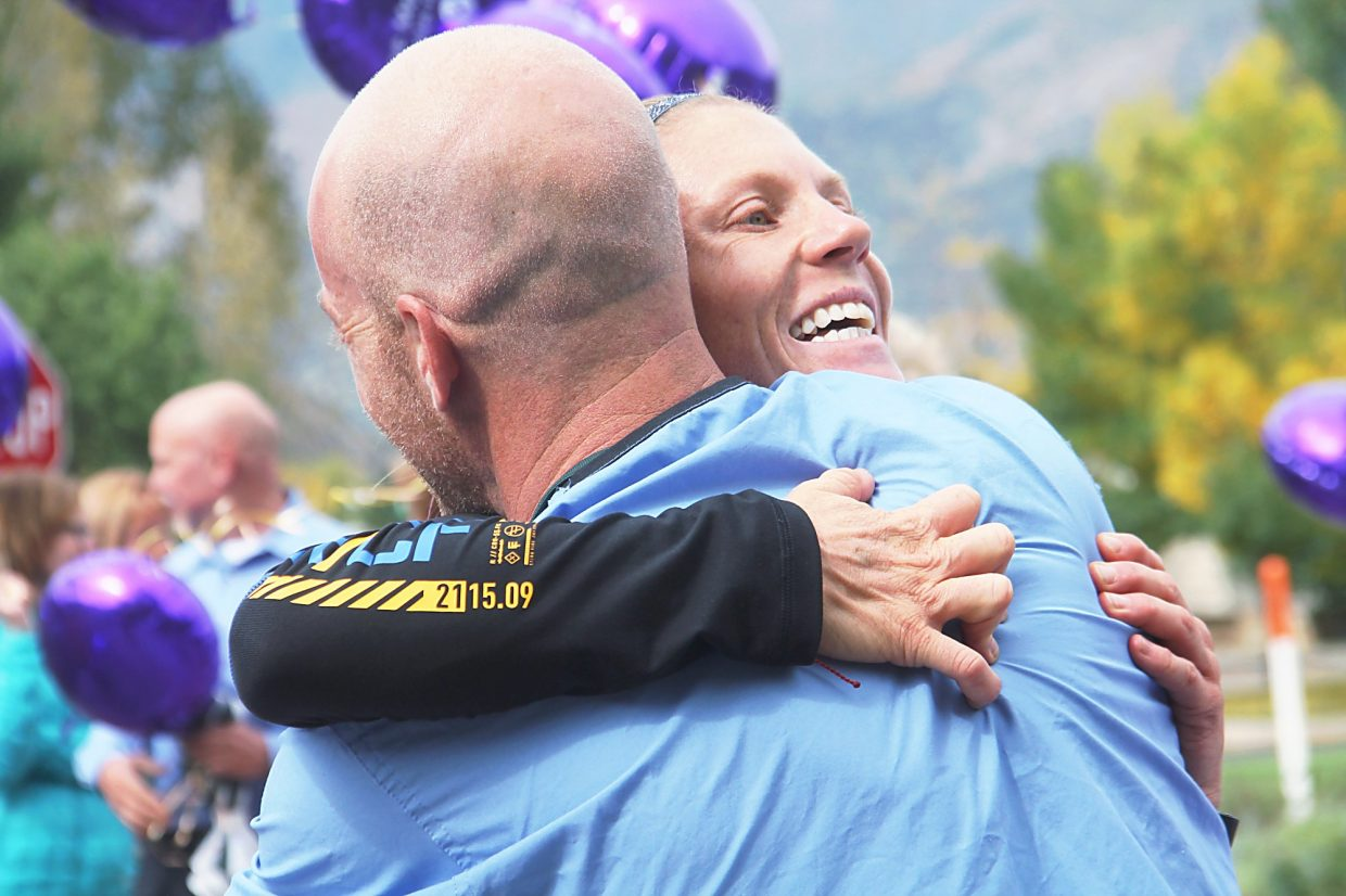 Jenny LaBaw gets a hug during Monday's stop at Valley View Hospital during her run across Colorado.