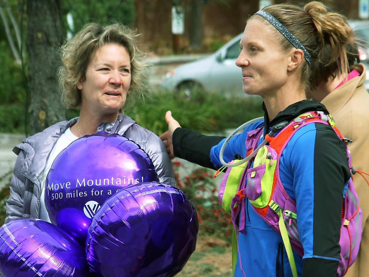 Jenny Labaw, a top CrossFit athlete who has epilepsy and is running the state to raise awareness, introduces her mother, Cathy Desautels, during Monday's stop at Valley View Hospital.