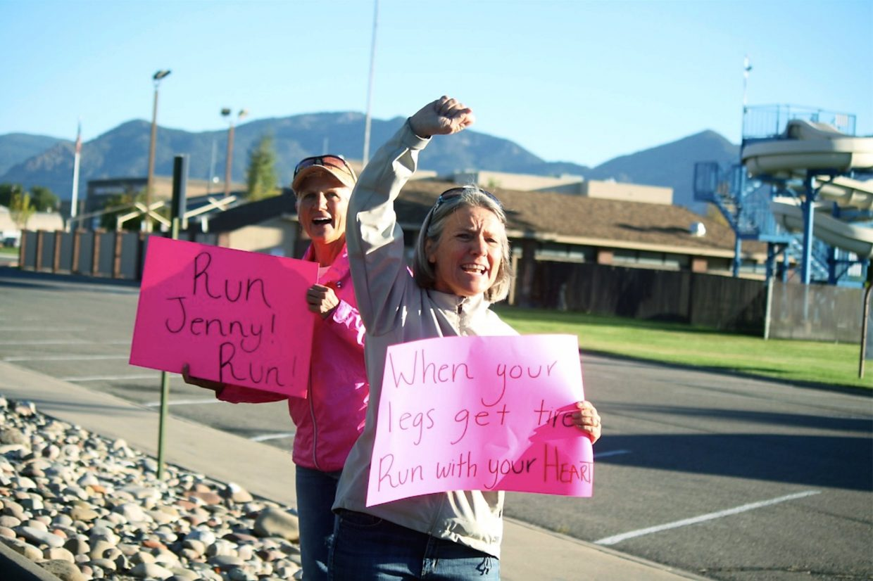 Supporters hold signs along Railroad Avenue as CrossFit athlete and Rifle native Jenny LaBaw heads north on her cross-state run to raise awareness and money for epilepsy.