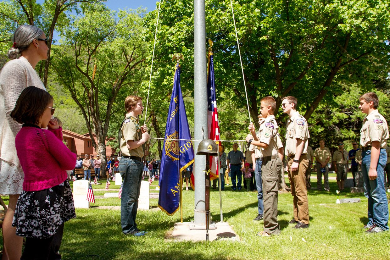 Boy Scout troop 225 lowered the Colorado and American flags at the Memorial Day ceremony at Rosebud Cemetery Monday morning.
