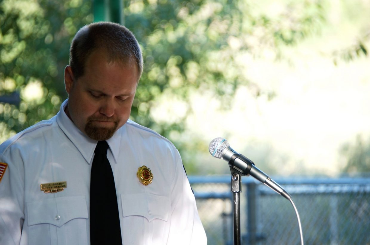 Jed Johnston, Grand Valley Fire Protection District chaplain, solemnly addresses the crowd at the memorial for Sarah Ogden.