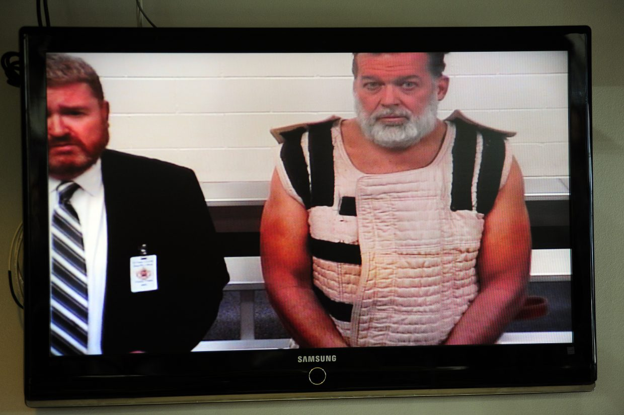 Colorado Springs shooting suspect Robert Dear, right, appears via video before Judge Gilbert Martinez, with public defender Dan King, at the El Paso County Criminal Justice Center for this first court appearance, where he was told he faces first degree murder charges, on Monday, in Colorado Springs.