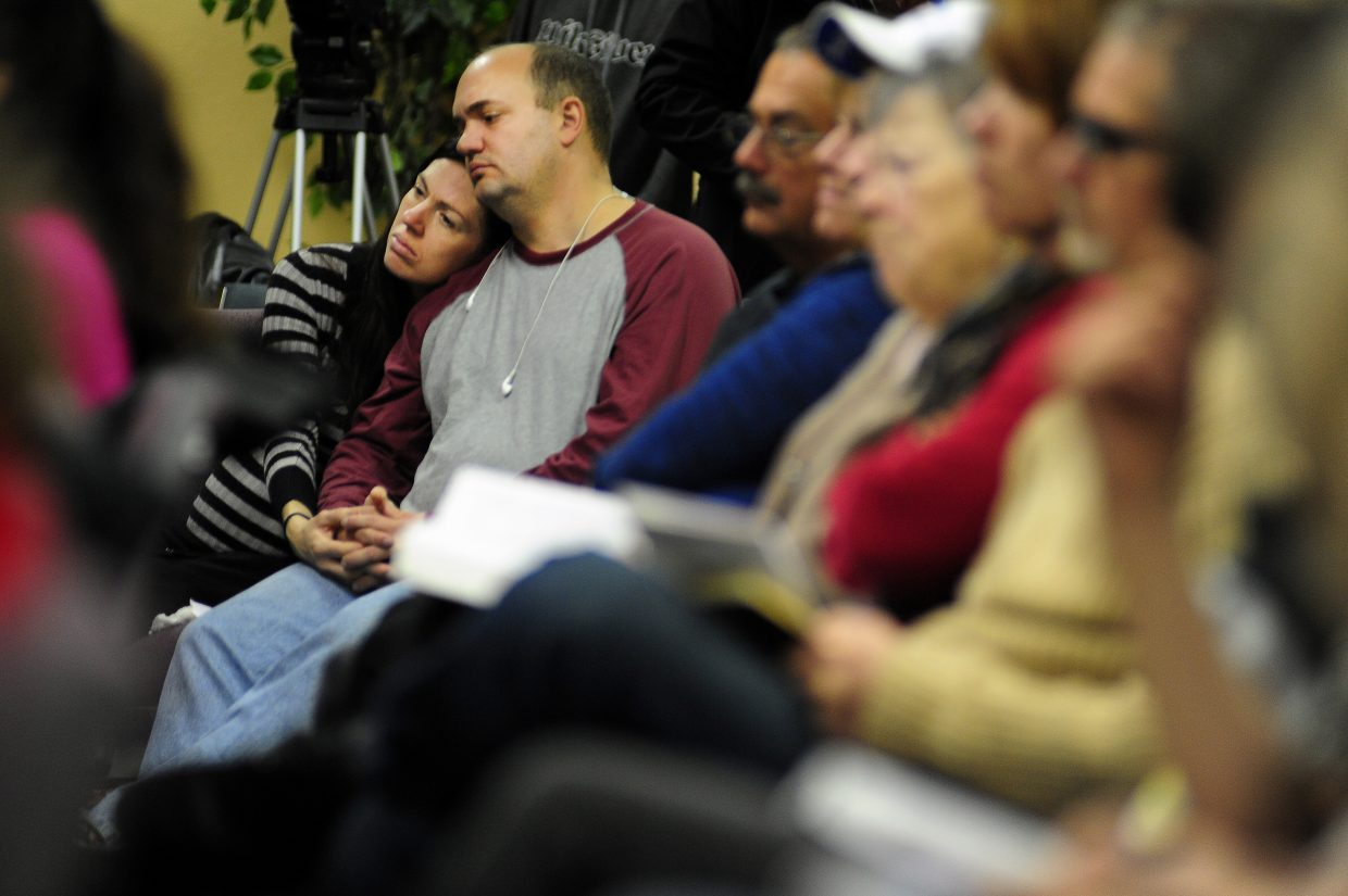 Scott Hanevik and his wife, Jessica, attend service at Hope Chapel in Colorado Springs, for the first service since one of their elders, Garrett Swasey, was killed during Friday's shooting at a Planned Parenthood clinic in Colorado Springs. Swasey, a 44-year-old police officer at the University of Colorado, was killed during Friday's shooting at the clinic.