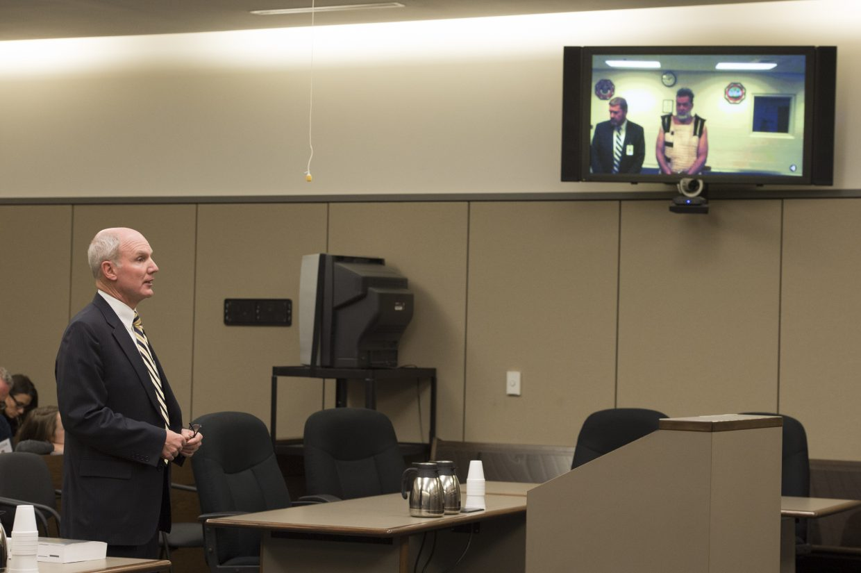 Fourth Judicial District Attorney Dan May, left, speaks Monday, during the first court appearance via video for Colorado Springs Planned Parenthood shooting suspect Robert Dear, where he was told he faces first degree murder charges, in Colorado Springs. At left is public defender Dan King.