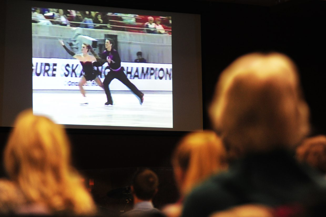 Members of Hope Chapel watch an old figure skating video of their elder, Garrett Swasey, on Sunday, in Colorado Springs, during their first service since Swasey was killed after responding to the Planned Parenthood shooting on Friday.