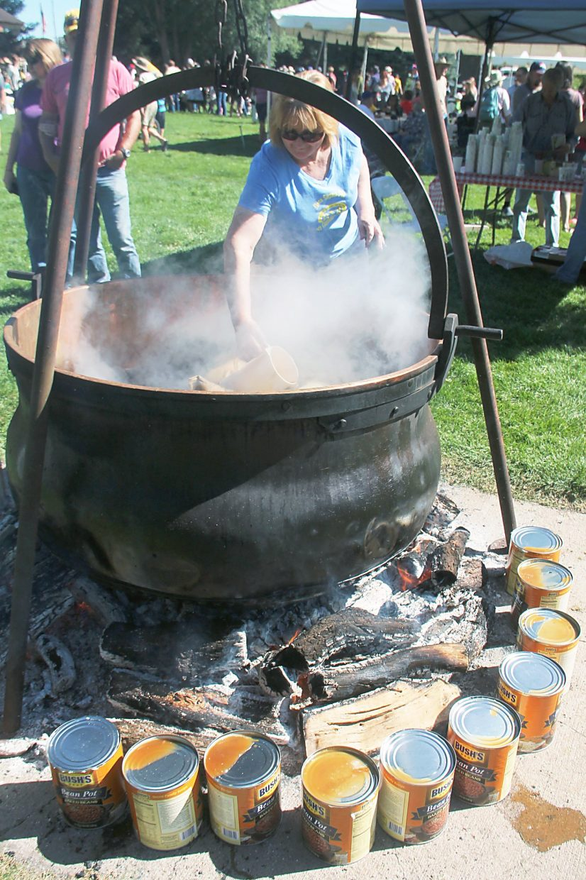 An ancient copper cauldron makes for plenty of cowboy coffee, and the beans get done on the side.