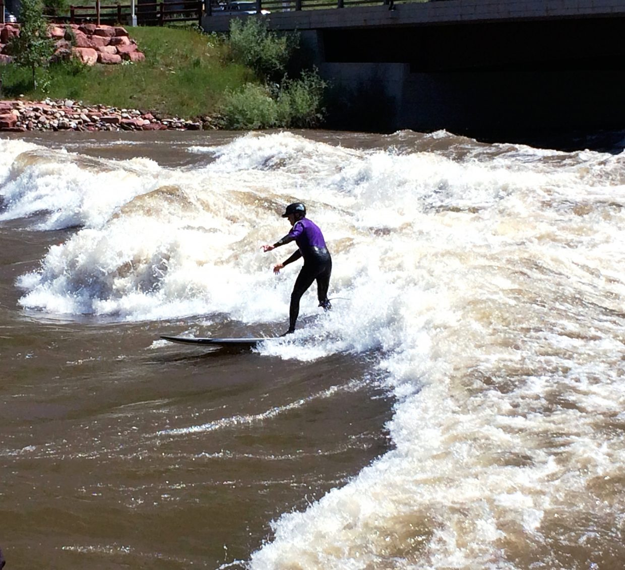 When not overseeing highway projects in the region, Joe Elsen can often be found on the river kayaking or, in this case, paddle boarding at the Glenwood Springs wave whitewater park.