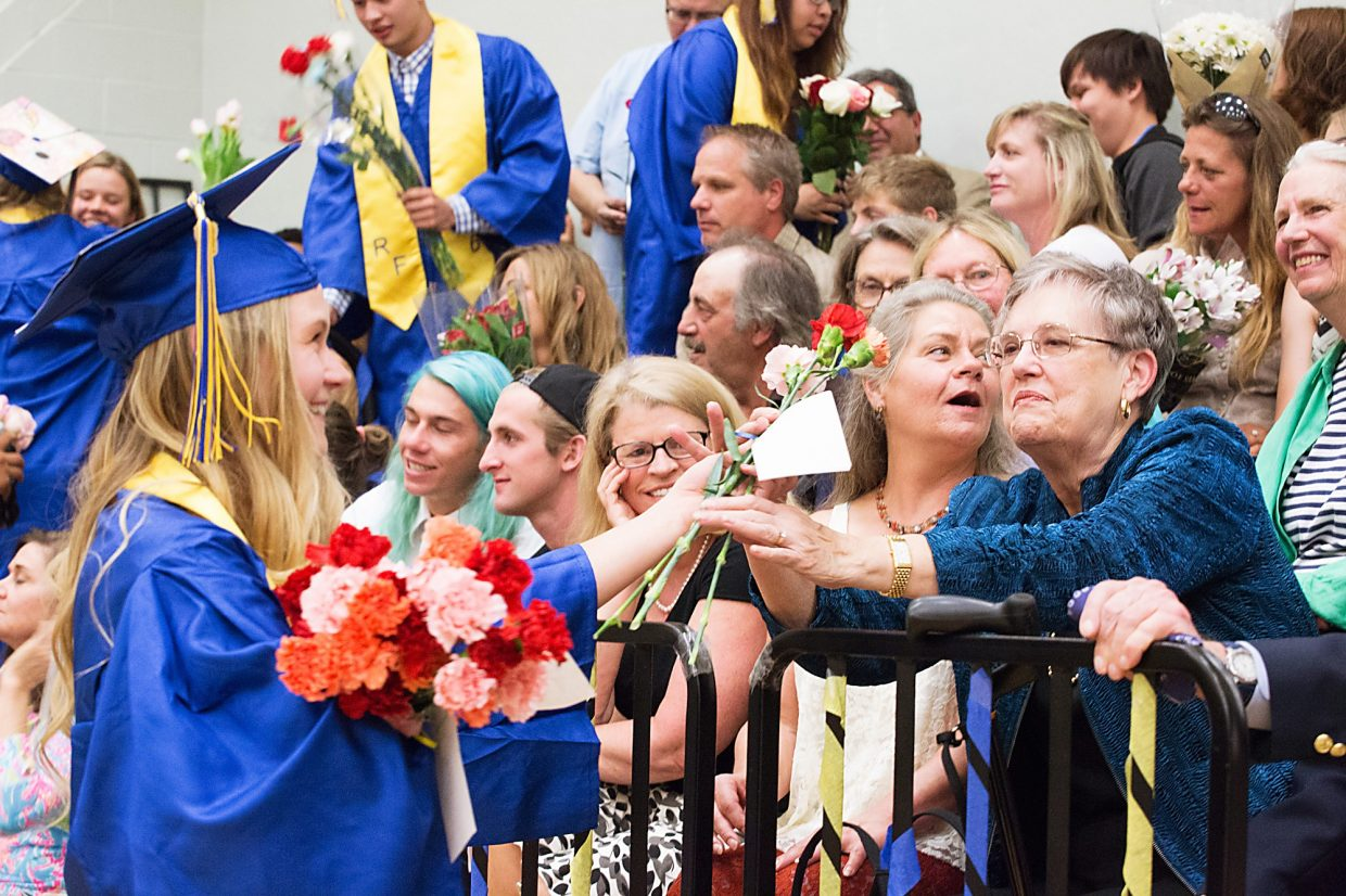 Roaring Fork graduate Daisy Contreras waits in queue during the graduation procession at Roaring Fork High School Saturday afternoon.