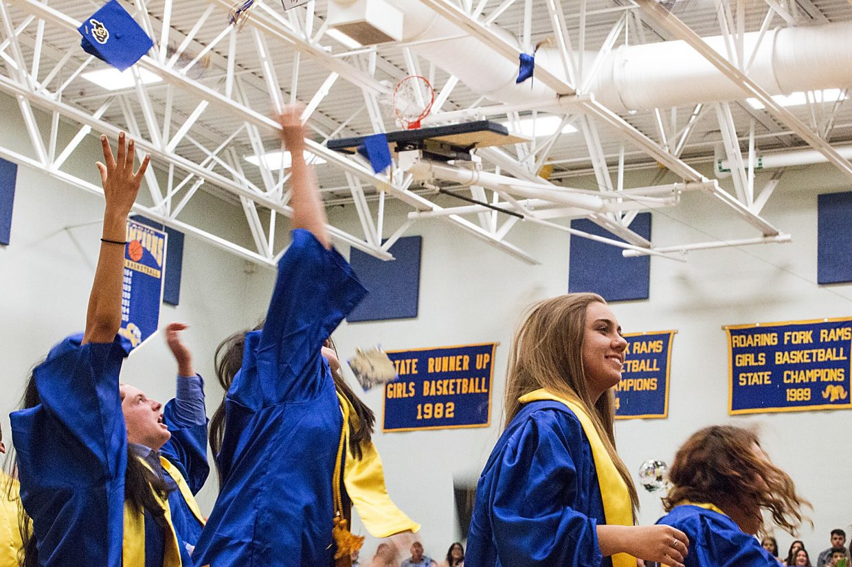 Roaring Fork High School graduate Kelly Walgren listens intently to one of the speakers during Saturday's graduation ceremony.