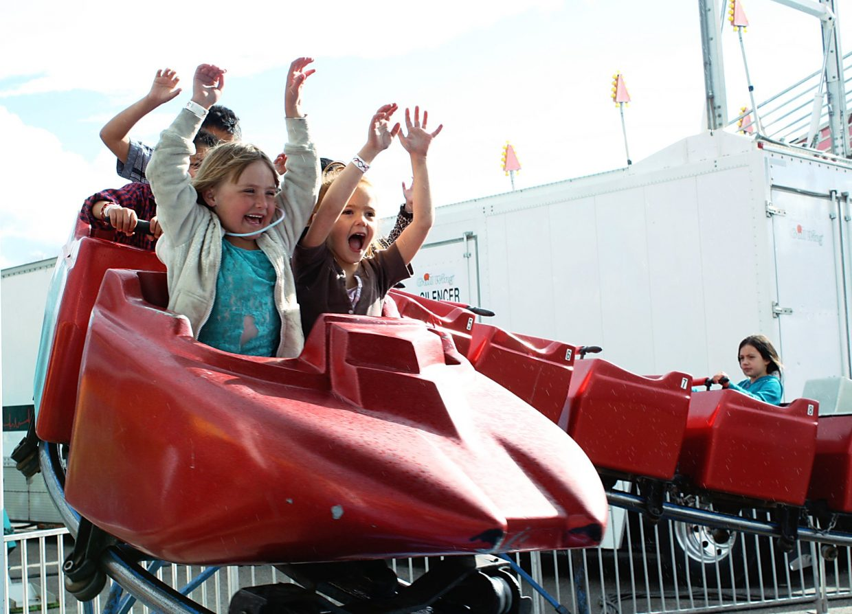 It's all smiling faces and flailing arms on the Super Jet amusement park ride.