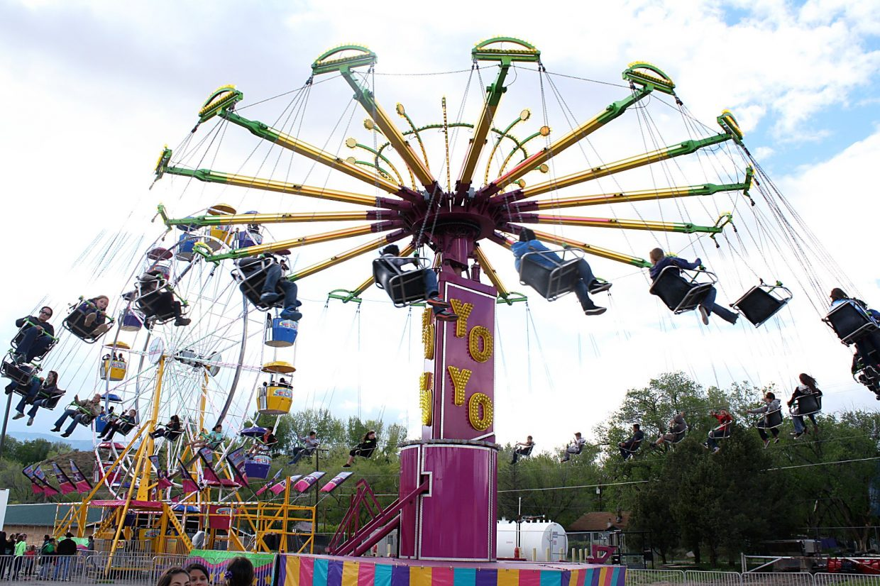Legs dangle from the Yo-Yo amusement ride high above the ground at the Garfield County Fairgrounds Saturday.