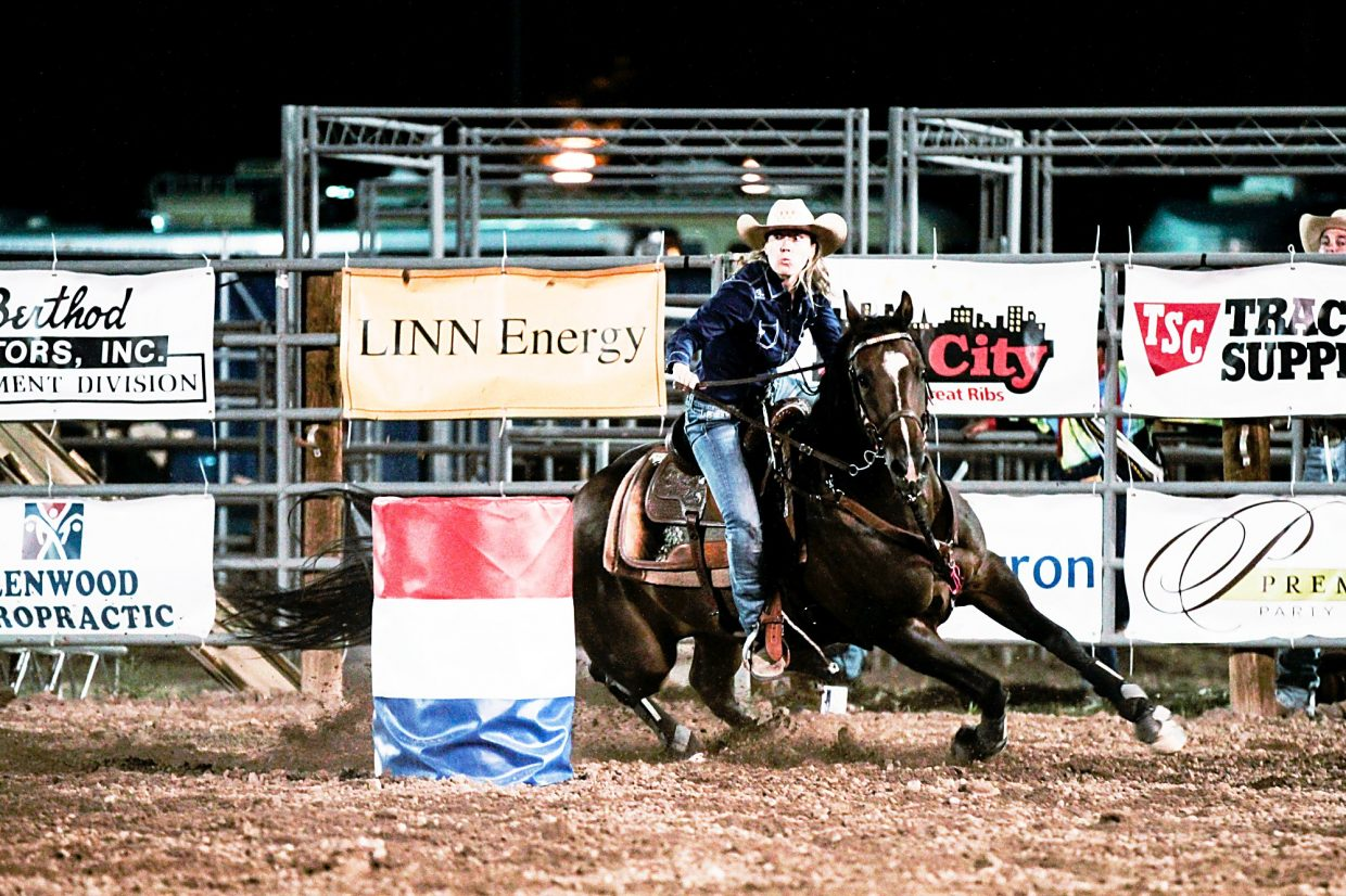 Ronnie Will of Silt makes a turn around a barrel during the barrel racing event at the PRCA Rodeo at the Garfield County Fairgrounds on Aug. 6. Will went on to win the local event for the second consecutive year.