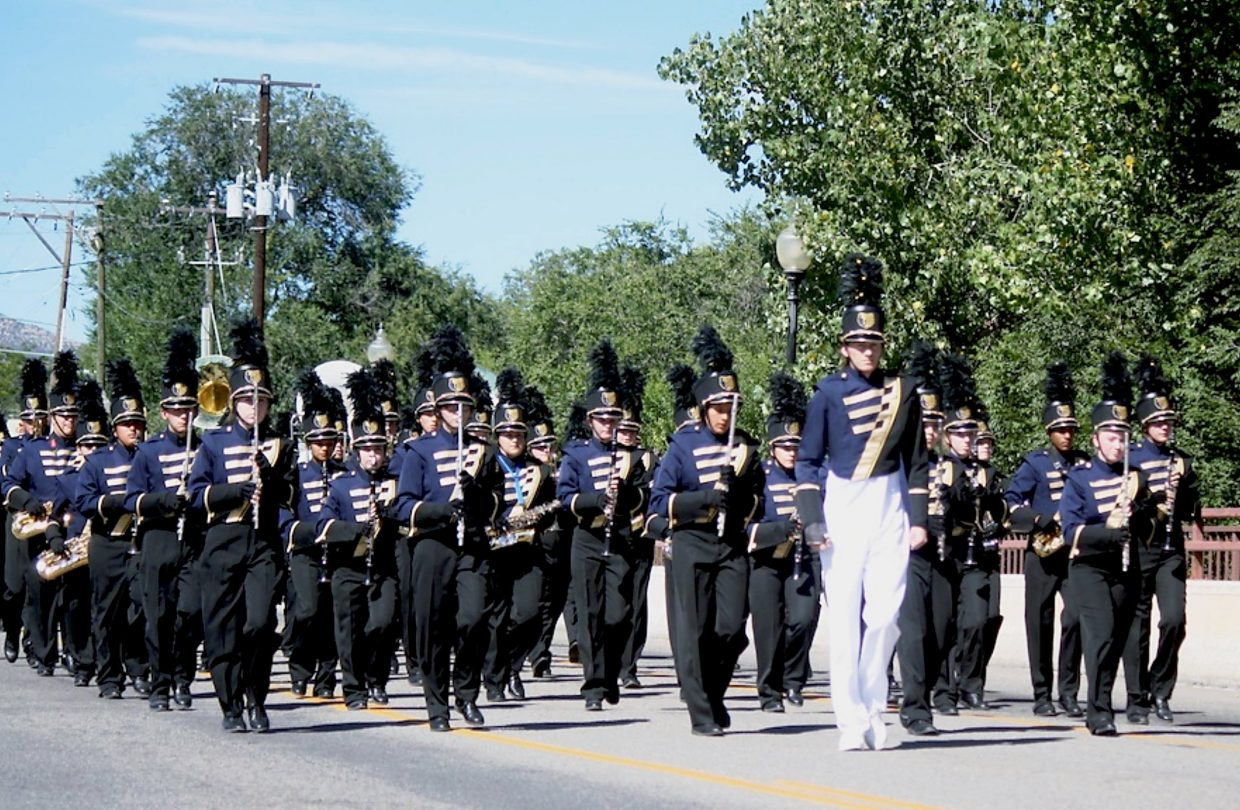 The Rifle High marching band leads the homecoming parade down Railroad Avenue Friday.