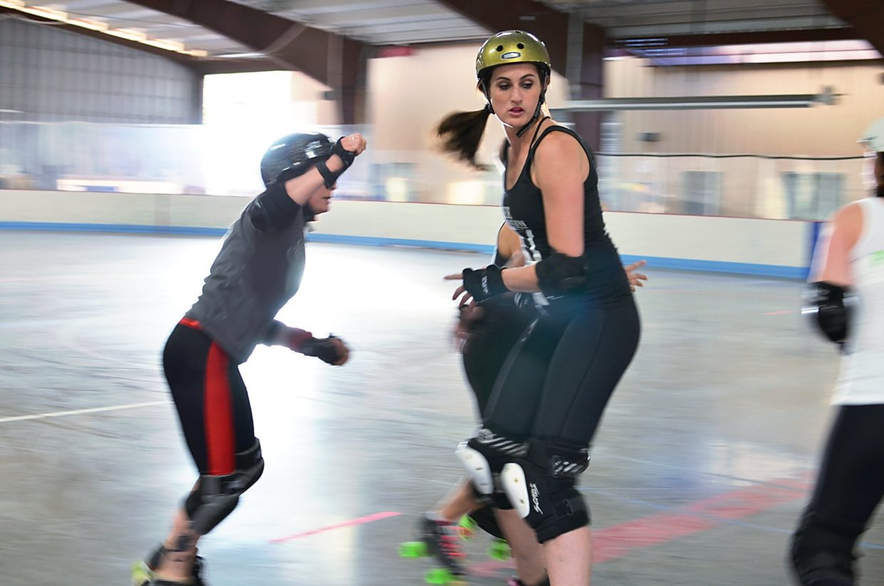 Diane Chapin (left) and Rachel Marquez (center) practice their moves on skates.