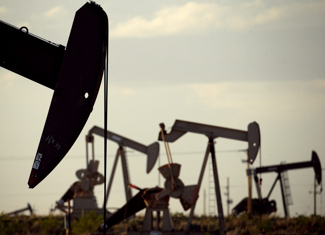 In this April 24, 2015 photo, pumpjacks work in a field near Lovington, N.M. As oil production in the United States rose in recent years, so did the spills of salty wastewater that is also pumped to the surface. A big reason why there are so many spills is the sheer volume of wastewater extracted - about 10 barrels for every barrel of oil, according to an organization of state ground water agencies.