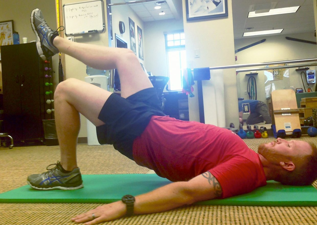 Glute bridges with James Sides, of Silverthorne. The U.S. Marine veteran moved to Colorado to train for his third year competing with the U.S. Paralympic Snowboardcross team.