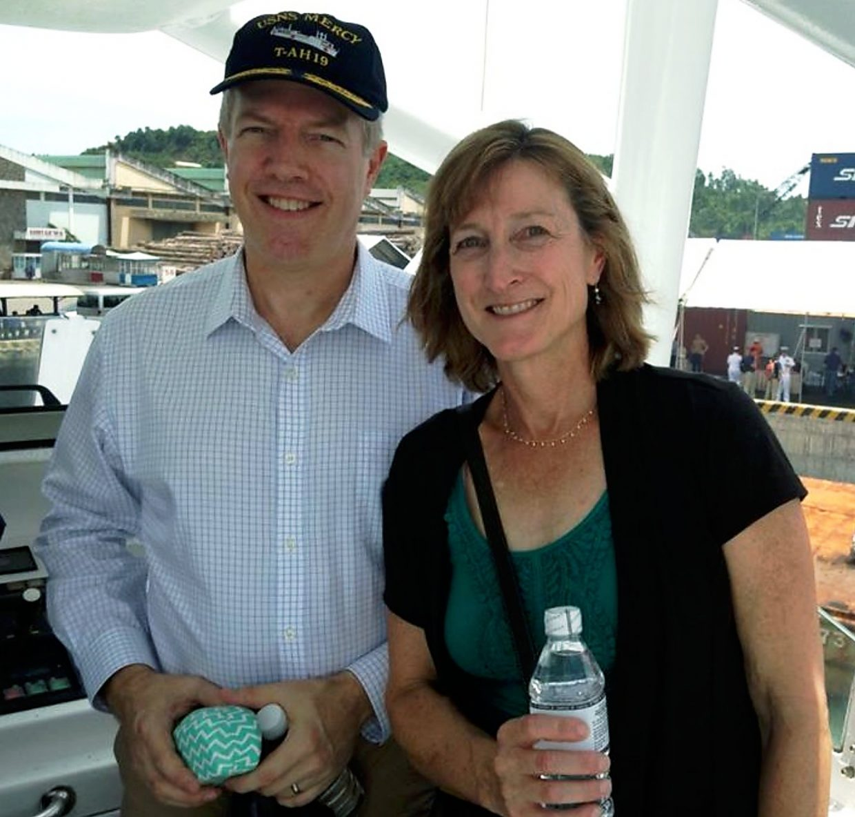 Alison Osius stands with her brother Ted Osius, the U.S. ambassador to Vietnam.