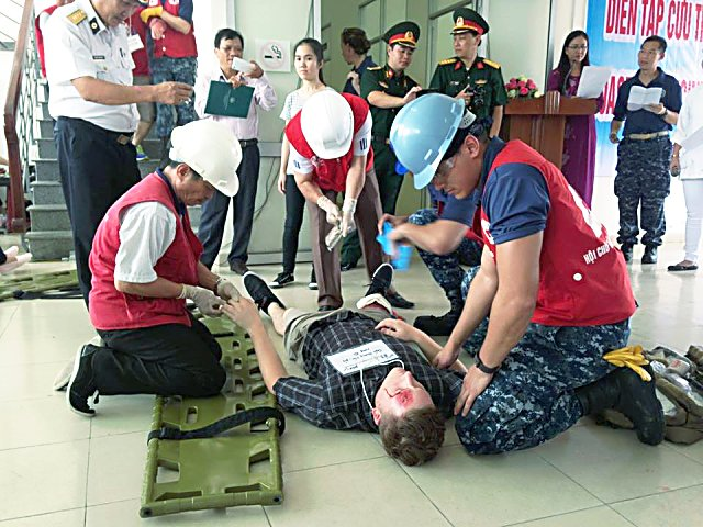 A disaster-response simulation for a tsunami was held aboard the USNS Mercy, in port on last leg of a five-month mission. The crew had trained local Vietnamese citizens such as fishermen as first responders.
