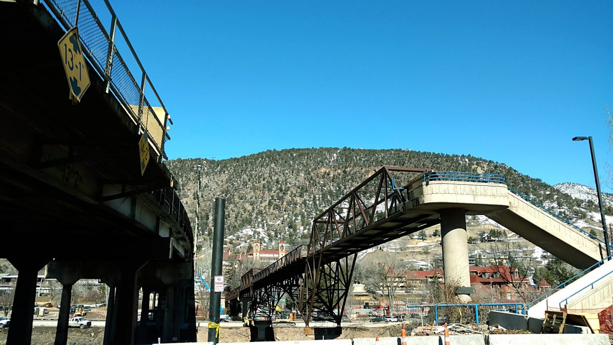Something's missing. Work crews overnight Tuesday tore down the catwalk that connected a metal ramp on the south side of the Grand Avenue bridge to the main pedestrian bridge over I-70 and the Colorado River.