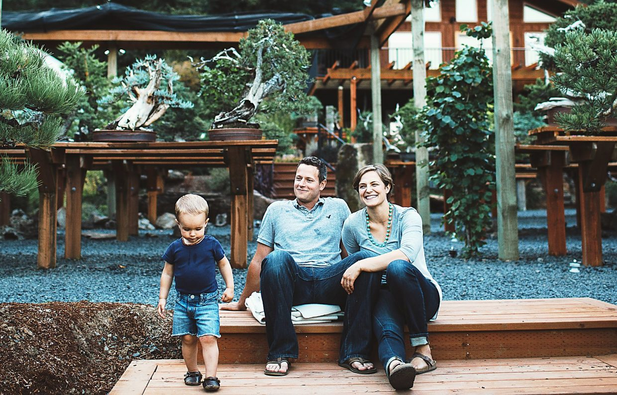 Glenwood Springs High School graduates and bonsai pioneers Ryan and Chelsea Neil hang out in their Bonsai Mirai garden in Oregon with son Taft.