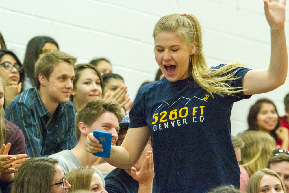 Olivia Dixon makes her way through Glenwood Springs High School classmates to claim the keys to a car she won at Thursday's Make the Grade assembly.