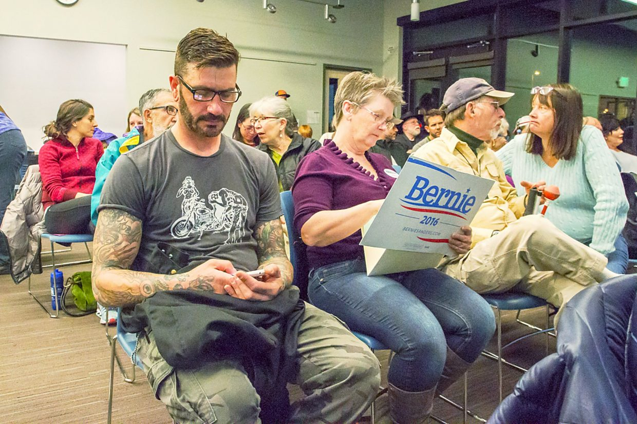Bobbie Hodge (center) was among a very full crowd at the Garfield County Library for the Super Tuesday caucus.