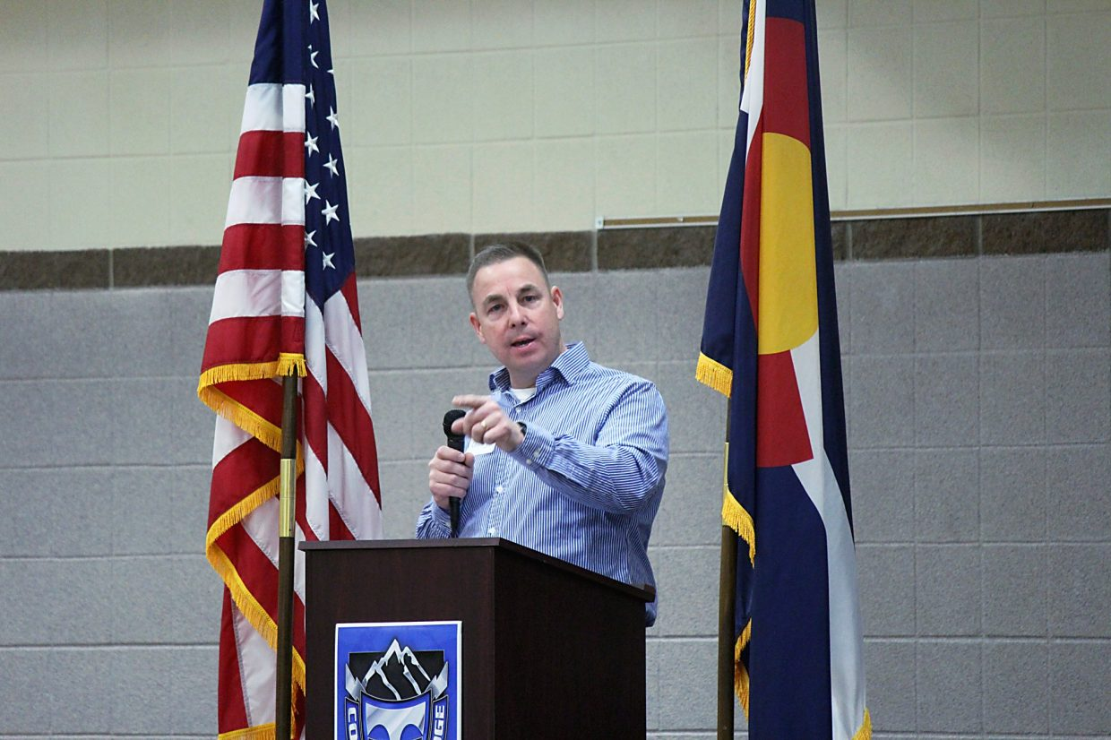 Jefferson Cheney delivers a speech detailing his candidacy for 9th Judicial District Attorney Tuesday night at the Republican caucus hosted at Coal Ridge High School.