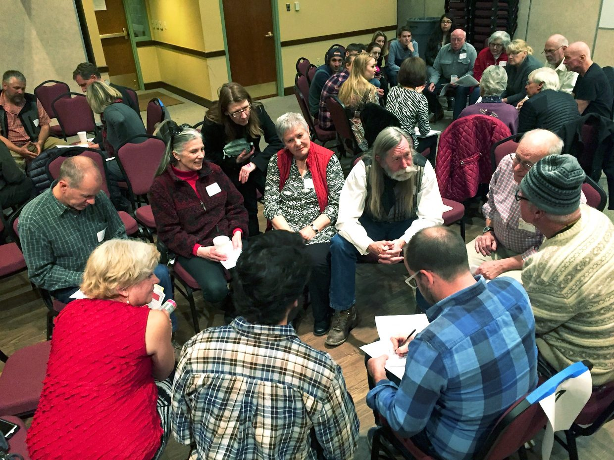 Garfield County Commissioner John Martin, center, leads the discussion regarding selection of precinct delegates to the March 12 Republican county assembly, during Tuesday night's precinct caucuses at the Glenwood Springs Community Center.