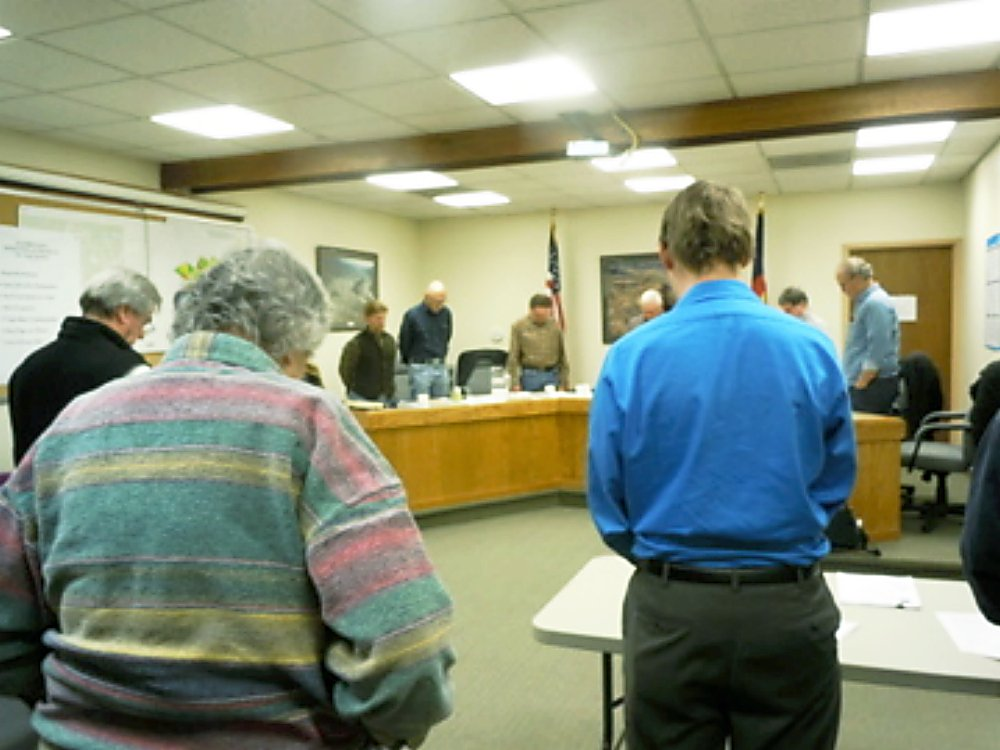 The New Castle Town Council observes a moment of silence at its meeting Tuesday to honor Air Force Capt. Will DuBois.