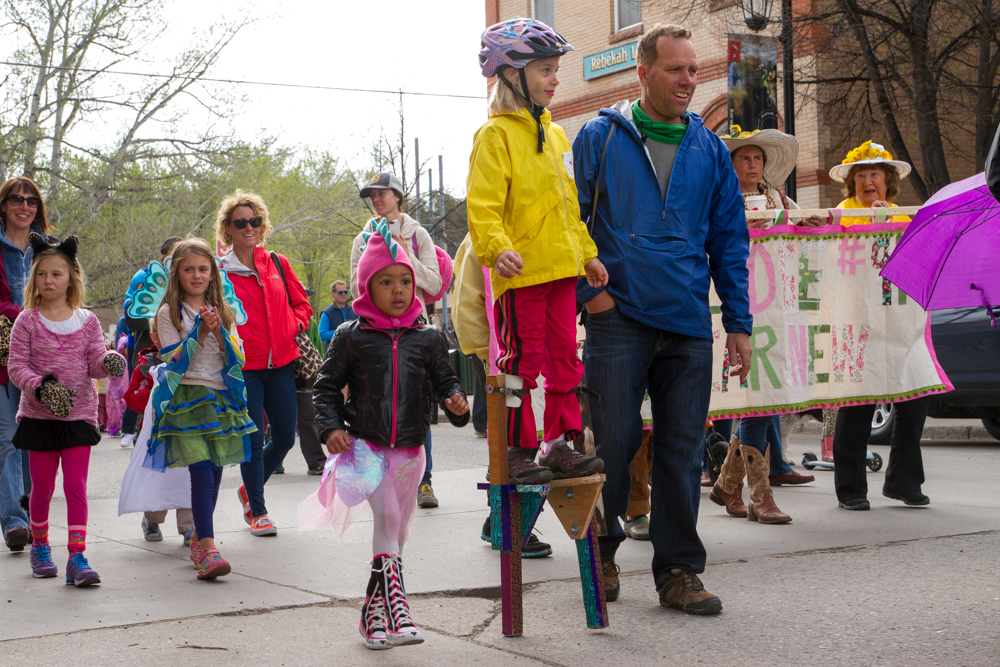 Eight year old Natasha Zucco walked the Dandelion Day Parade down main street Carbondale on stilts Saturday morning. The parade opened with dancers and music and was followed by dinosaurs and animal customes of all species.
