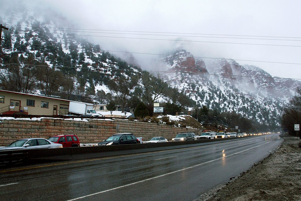 The usual line of cars backs up on Highway 82 at the south edge of Glenwood Springs as upvalley workers return home in the late afternoon.