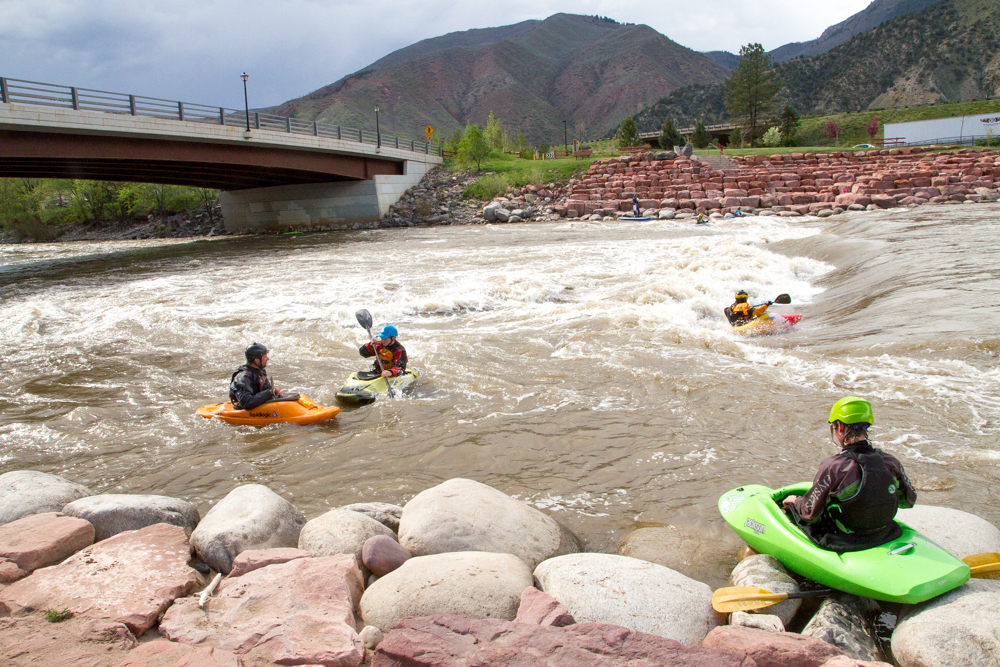 More kayakers and stand-up paddle boarders are taking to the waves as the water begins to rise at the White Water Park in West Glenwood Springs.
