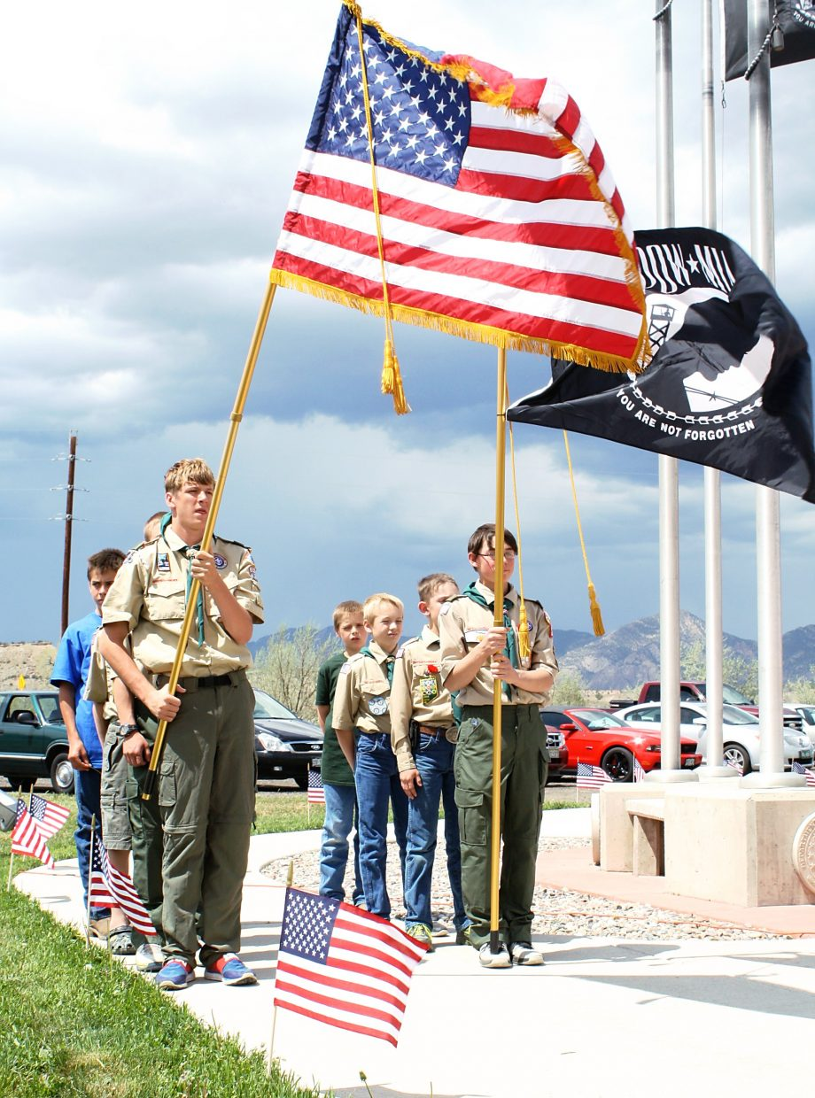 Scouts from Rifle Boy Scout Troop 223 present the colors to start a dedication ceremony at the Western Garfield County Veterans Memorial May 3.