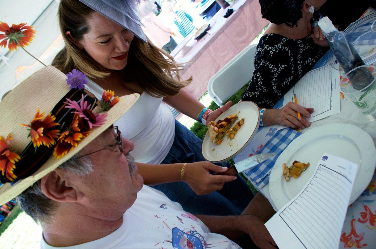 Frank Norwood gets ready to taste a piece of pie, served by Carly Debeque, at the pie baking contest during Mountain Fair on Saturday. The theme this year was