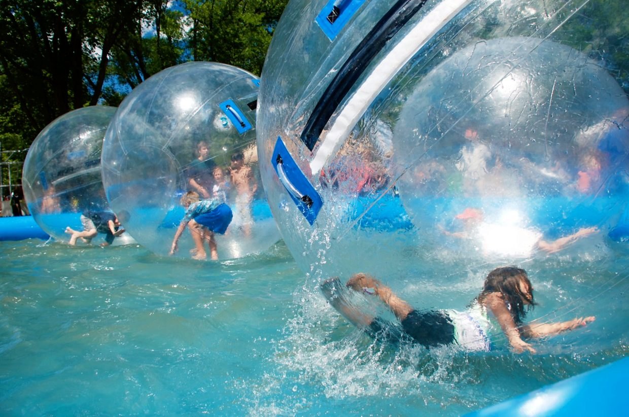 The water balls were one of the most popular kids' attractions at Mountain Fair on Saturday, which was sunny and hot.