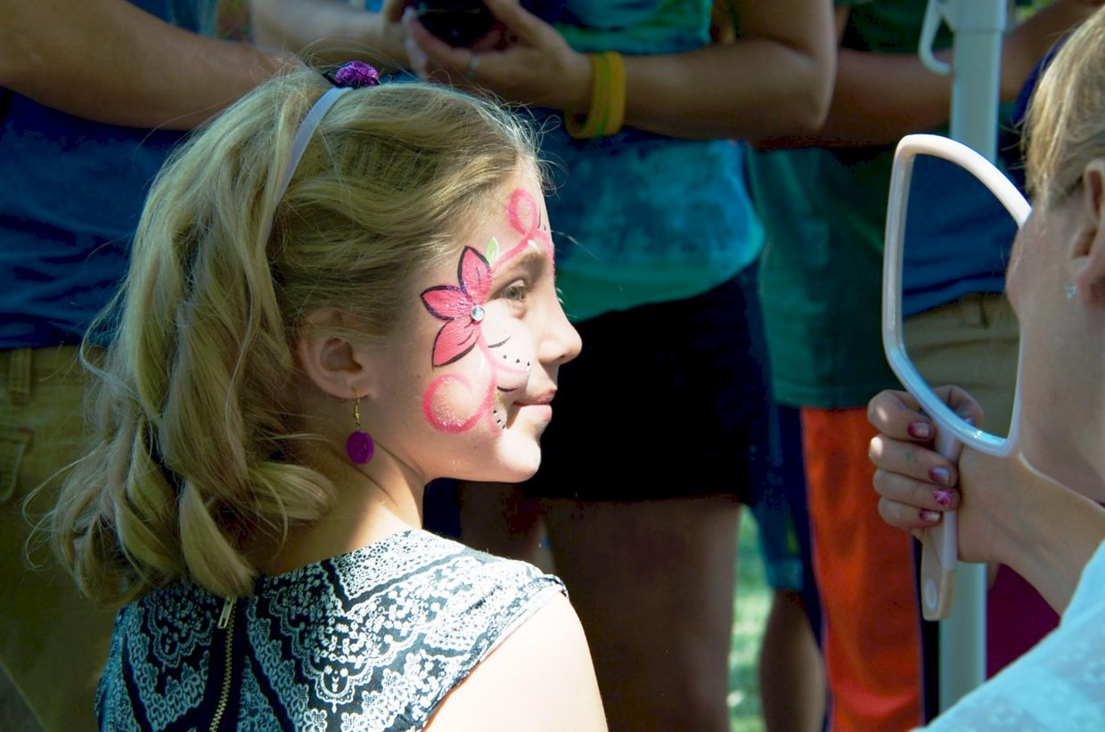 Nina Leslie, from Marble, gets her face painted at Mountain Fair on Saturday afternoon.