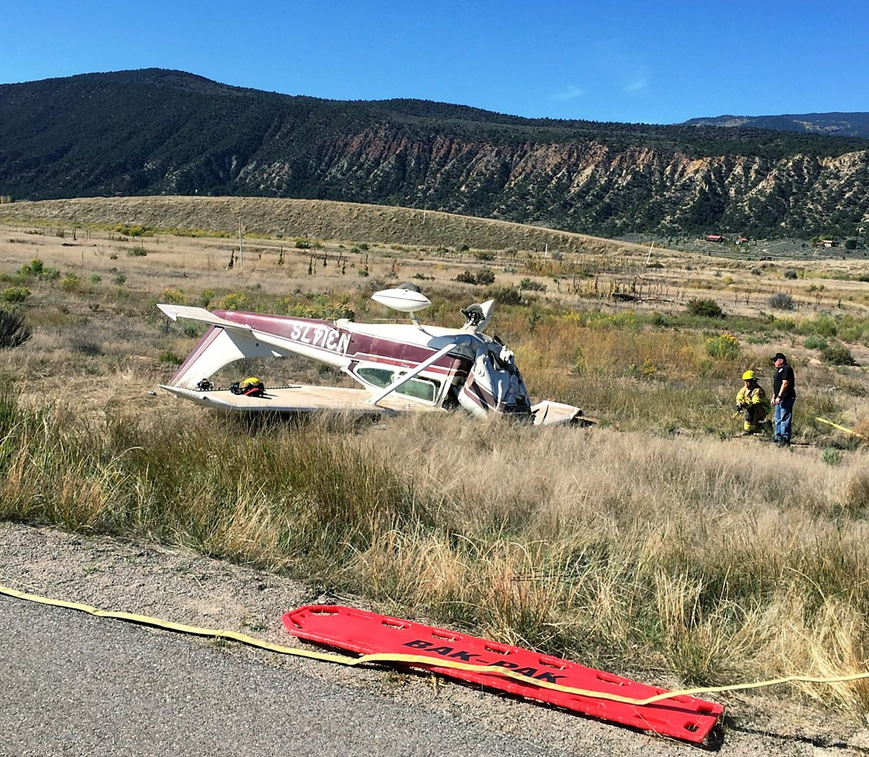 A plane rests upside down after crashing Sunday morning near Cattle Creek alongside the Rio Grande Trail.