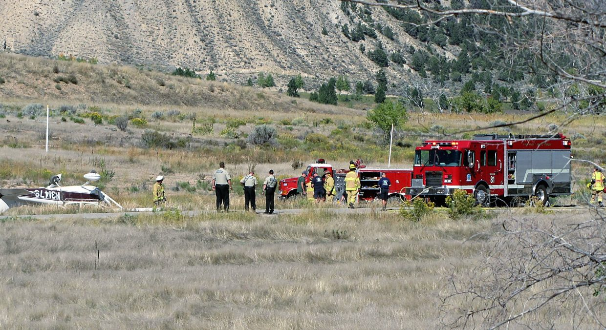Emergency crews get ready for investigation and cleanup Sunday of the airplane crash scene south of Glenwood Springs.